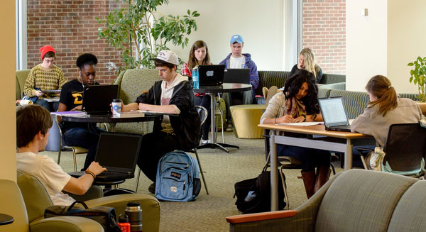 Students studying in small groups in Davis Library