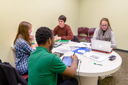 Students working in an Undergraduate Library study room