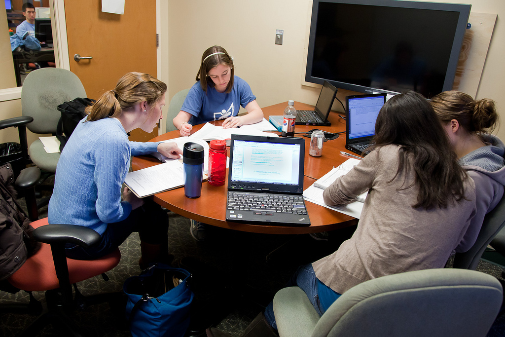 Students studying at a table in the Health Sciences Library First Floor