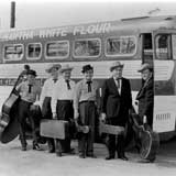 Musicians boarding 'Field Trip South' bus