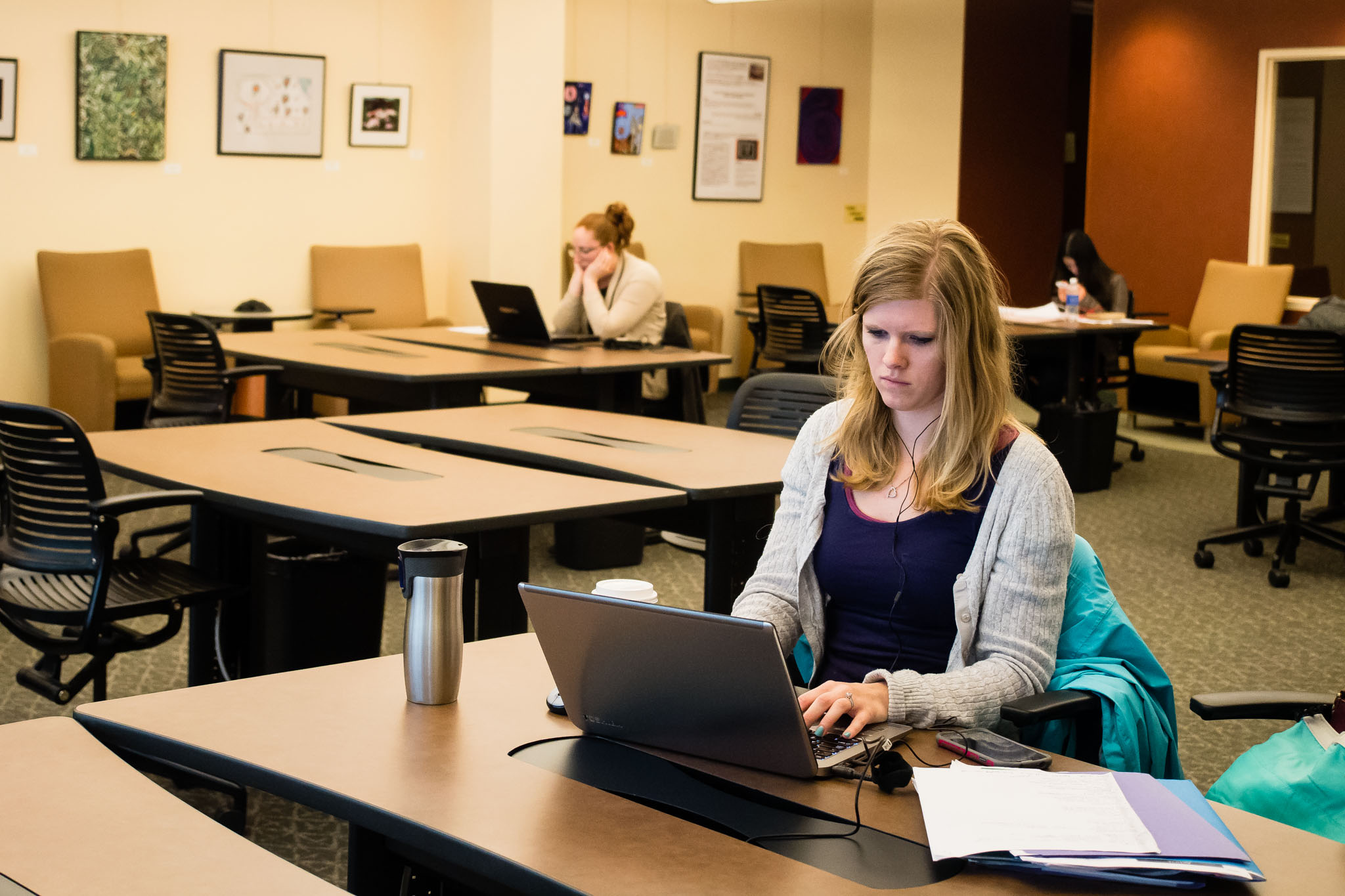 Students studying at tables in Health Sciences Library second floor