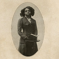 Black and white photograph of woman holding a book