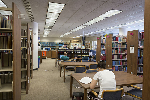 A view of the first floor of the Art Library with students studying