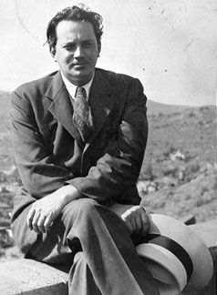 Thomas Wolfe sitting on wall