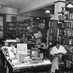 Four white women and men in a bookstore.