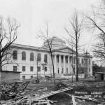 A black and white view of the front of Wilson Library from the northeast. with construction debris in the foreground.