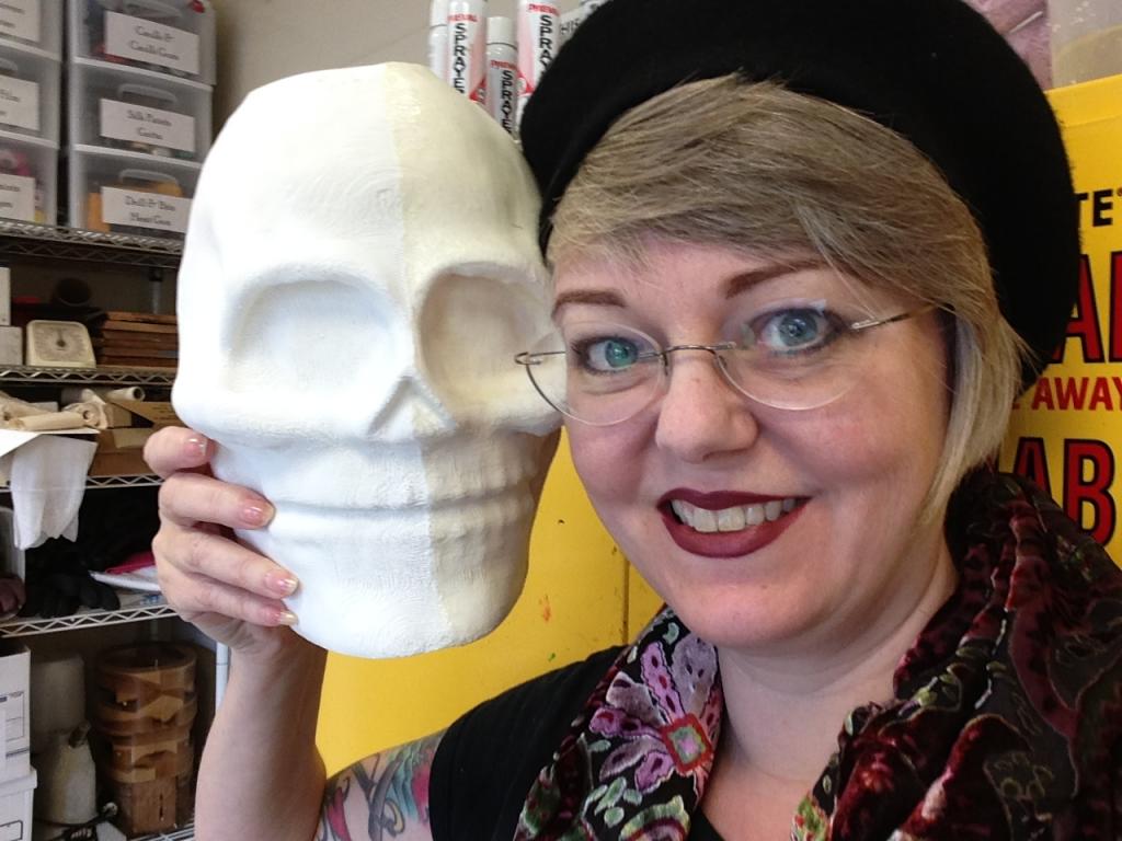 Rachel Pollock holding mask