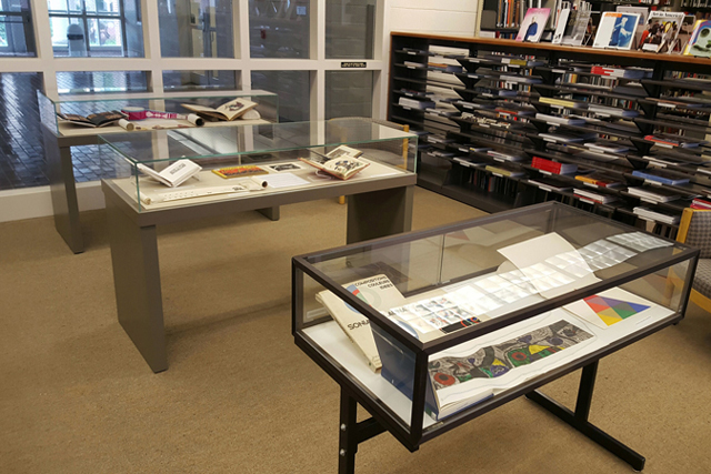 display cases holding documents in the Sloane Art Library