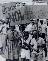 African-American protesters holding anti-segregation signs