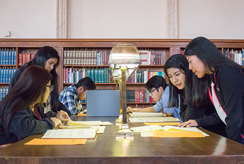 Students reviewing primary source material in Wilson Library