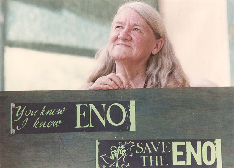 "Margaret Nygard with signs reading ""You know I know Eno"" and ""Save the Eno"""