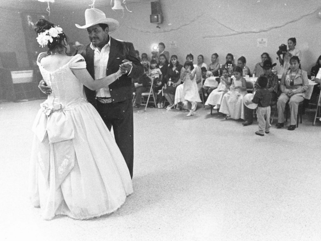 Photograph of father and daughter dancing.