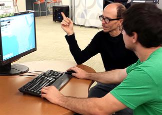 librarian instructing patron using computer