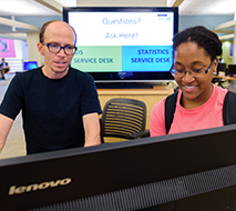 librarian and student working at a computer