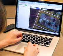 person working with GIS software on a laptop