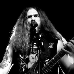 Photogrraph of Greg Klaiber with guitar