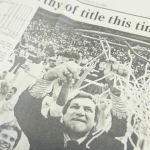 Newspaper photograph of Dean Smith cutting a basketball net