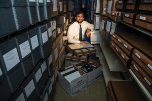 UNC Library's Bryan Giemza with items from the Jim White Collection at Wilson Library. Photograph by Grant Halverson.