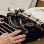 Hands of Tim Youd with his typewriter