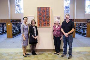 Elaine Westbrooks, Carol Folt, Sarah Michalak, and Tim Shearer with painting by Martin Tjampitjinpa