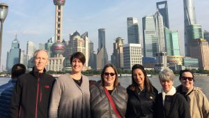 Nandita Mani and librarians. Shanghai skyline in bakcground.