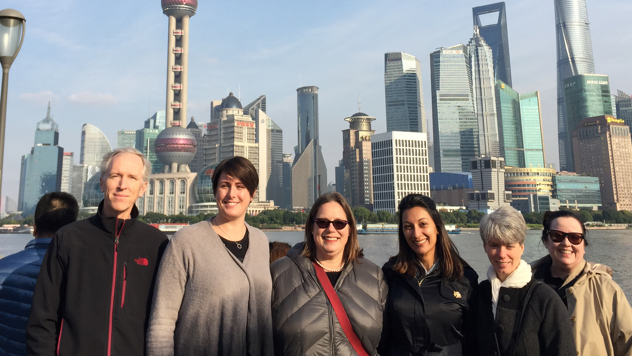 Nandita Mani and librarians. Shanghai skyline in bakcground.