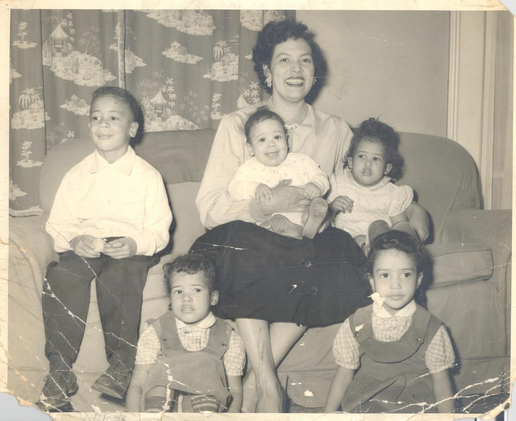 Mary Louise Lewis (wife of WRAL broadcaster, J.D. Lewis) on a couch in her Raleigh, NC home with her five children in the early 1950s