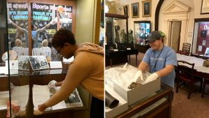 Maya Brooks and Wesley Thompson working on exhibits in the North Carolina Collection Gallery
