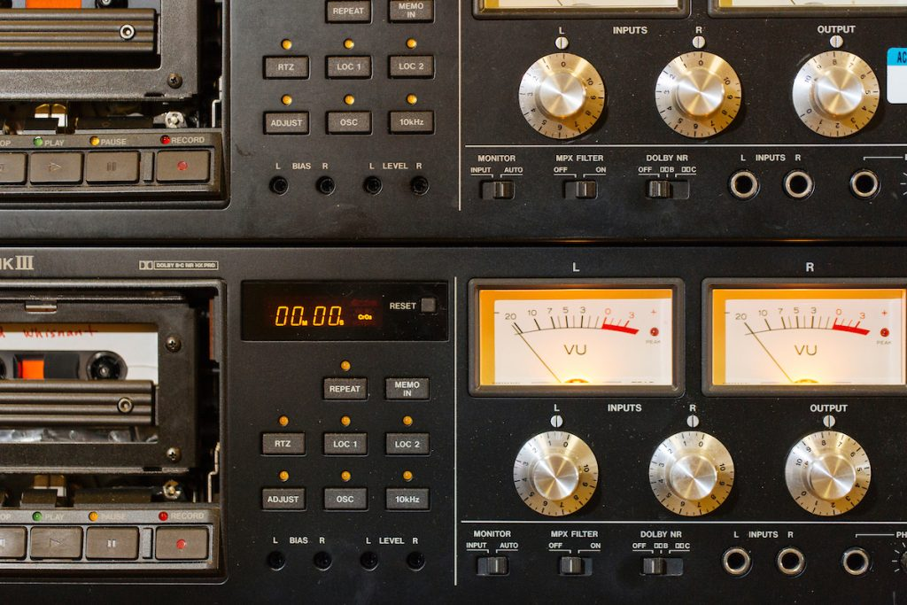 Close up of two audiocassette decks including VU meters
