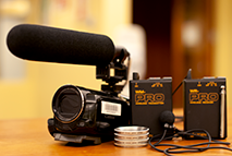 handheld video camera with attached microphone
