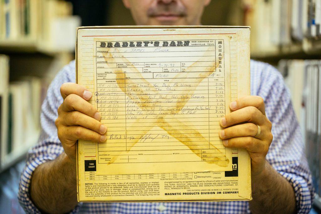 """Steve Weiss holding """"Bradley's Barn"""""""
