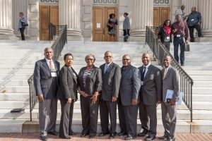 seven African-Americans stand in front of Wilson Library
