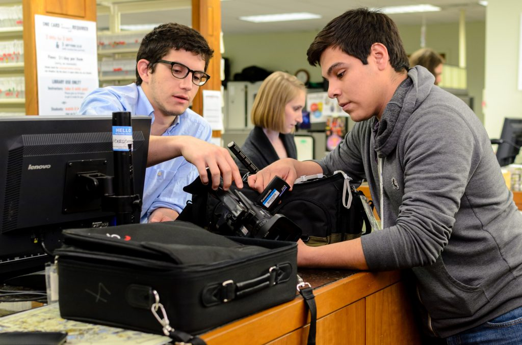 Students check out equipment from the Media Resources Center