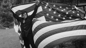 Johnny Cash holding American flag