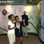 Visitors viewing an exhibit in the Tuskegee History Center