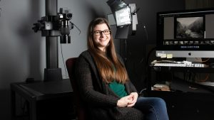 Kerry Bannen sitting for a portrait in Wilson Library digital production center