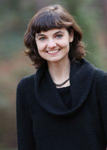 Portrait of Emily Brassell wearing a black shirt