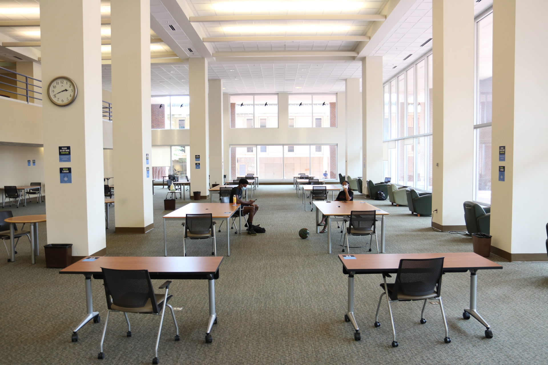 study tables in Davis Library spaced 6 feet apart