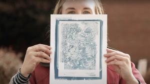 Artist Lulu Zilinskas holds print