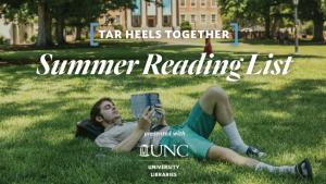 man reading book on grass