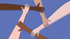 hands of various skin tones coming together to form a circle